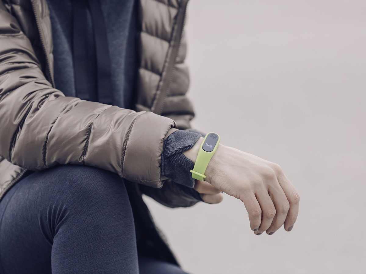 Runner wearing fitness tracker watch